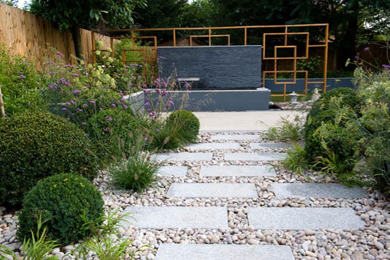 Sten i trädgårdens design