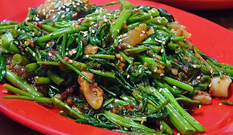 Wokade asiatiska bladgrönsaker