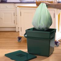 Nedbrytbar kompostpåse av stärkelse för komposthink