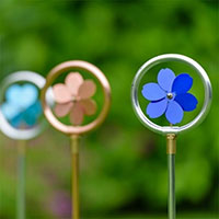Flopro reterande sprinkler med blommotiv