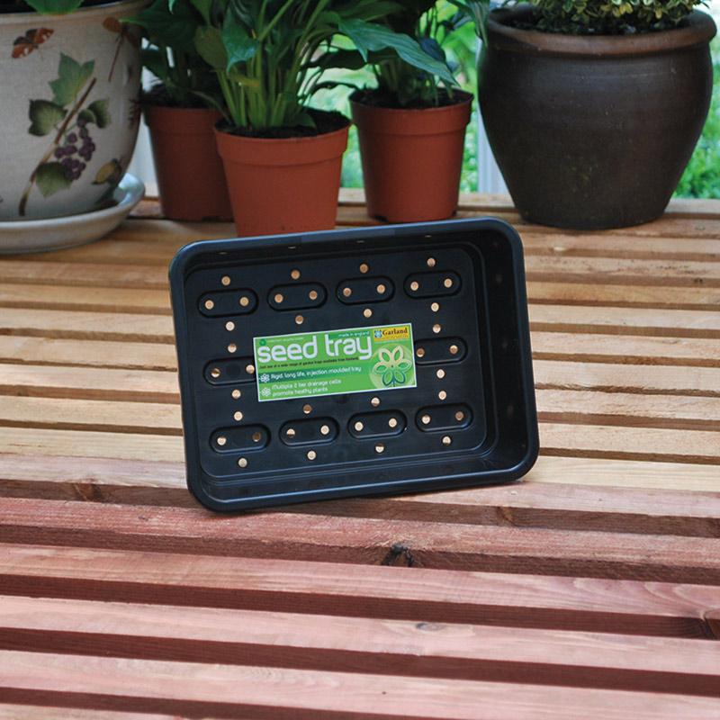 Grön sålåda med hål i kraftig plast