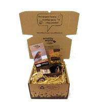 Presentbox med fågelbo och fröer