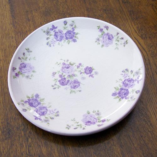 Fat lilablommigt i keramik-ytterkruka i lila keramik