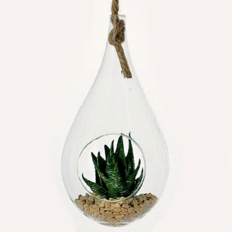 Glasdroppe med öppning för små växtarrangemang